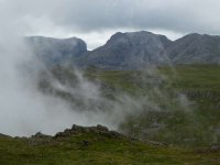 Scafell and Scafell Pike appear out of the cloud